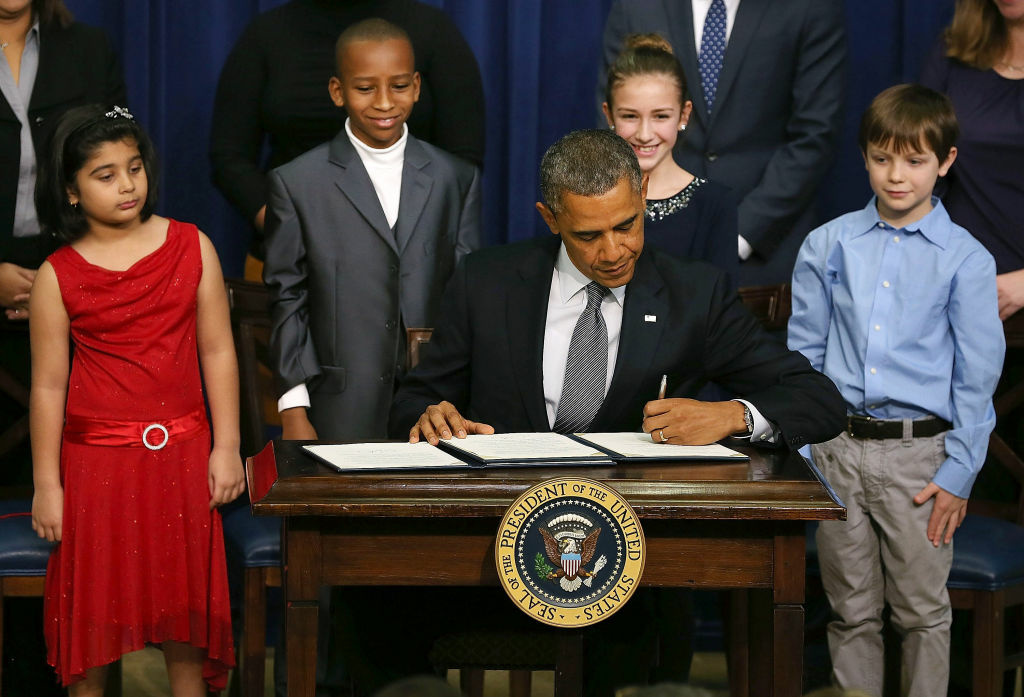 U.S. President Barack Obama signs a series of executive orders about the administration's new gun law proposals on January 16, 2012 in Washington, DC.