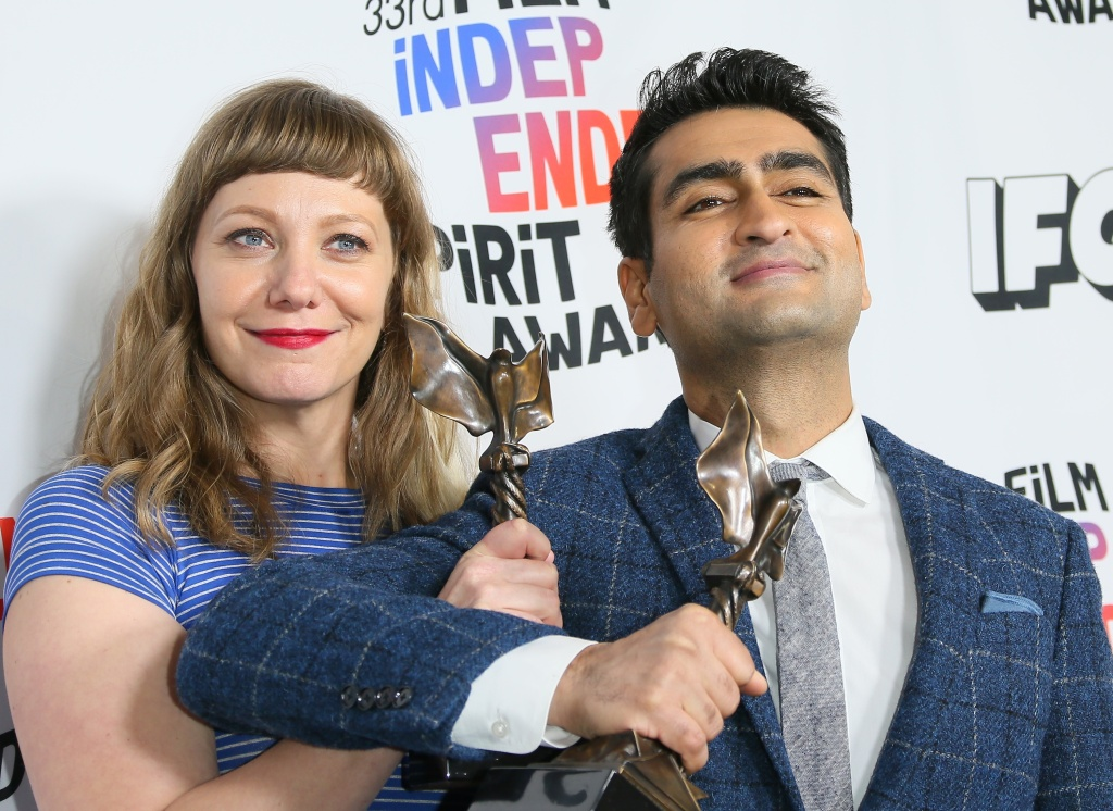 Emily V. Gordon and Kumail Nanjiani pose with their Best First Screenplay award for