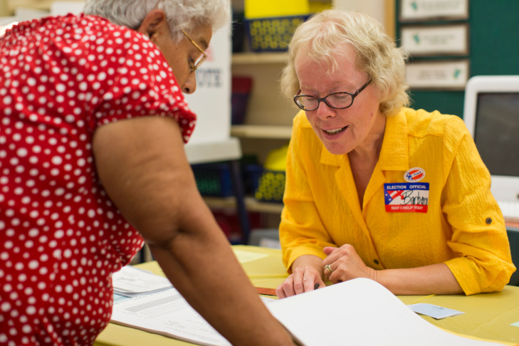 Poll clerk Barbara Rotelli helps look up voter information at Canyon Springs School's library on Tuesday evening, June 3, 2015, in Santa Clarita during a Los Angeles County primary election. Santa Clarita is one of the only about 15 cities in Los Angeles County with more registered Republicans than Democrats.