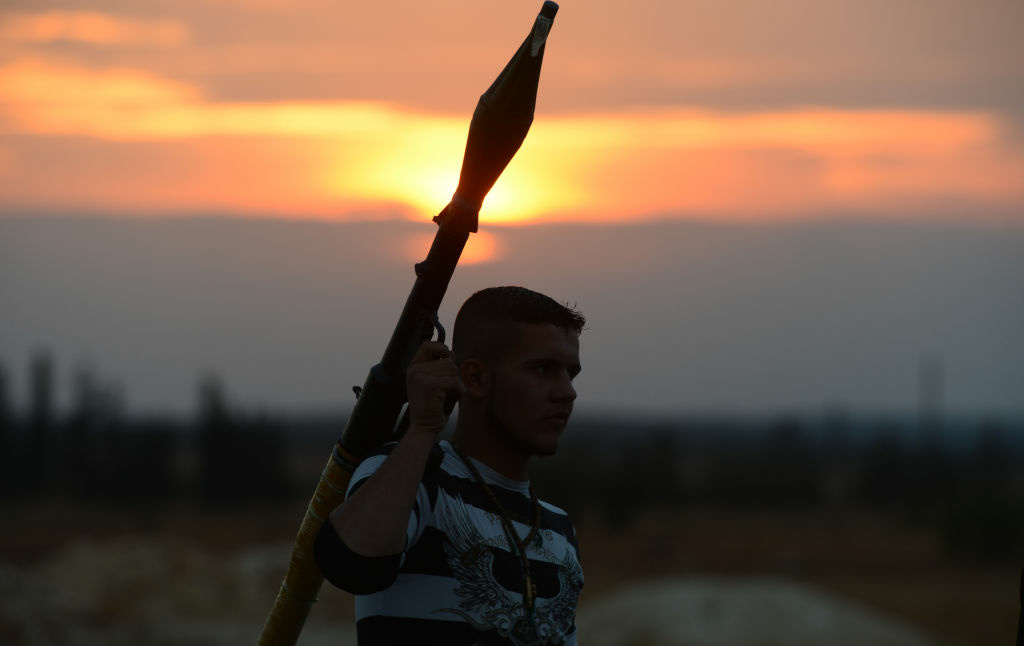 A Syrian rebel holds a rocket-propelled grenade launcher near a post in the rebel-held Syrian city of Minbej on October 10, 2012. The Syrian regime rejected a UN call for a unilateral ceasefire as rebels confronted columns of tanks and troops sent to retake a town on the road to main battleground city Aleppo.