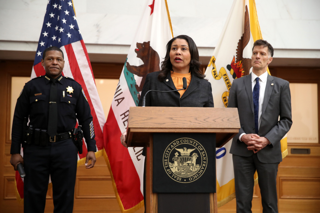 San Francisco Mayor London Breed (C) speaks during a press conference as San Francisco police chief William Scott (L) and San Francisco Department of Public Health director Dr. Grant Colfax (R) look on at San Francisco City Hall on March 16, 2020 in San Francisco, California.