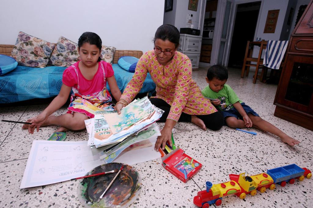 Dola Banerjee homeschools her children in New Delhi in August.