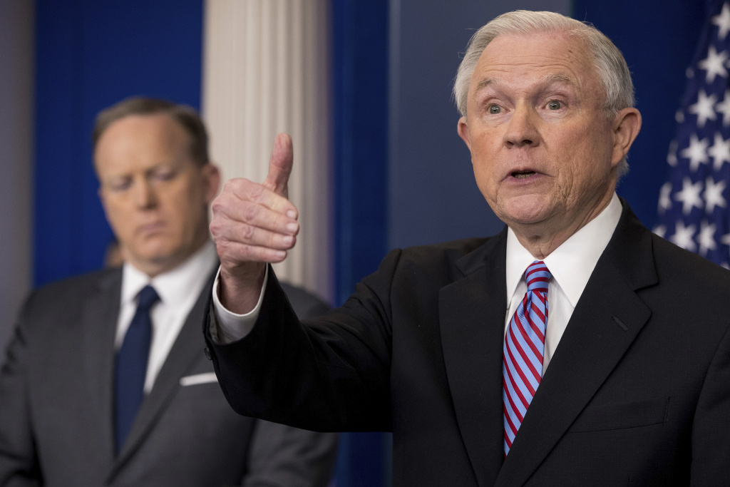 Attorney General Jeff Sessions, right, accompanied by White House press secretary Sean Spicer, talks to the media during the daily press briefing at the White House in Washington, Monday, March 27, 2017.