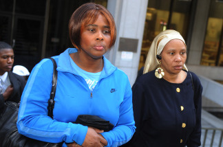 File photo:  Wanda Johnson (C), the mother of victim Oscar Grant, leaves a pretrial hearing for Johannes Mehserle, the former Bay Area Rapid Transit officer charged with murder in the shooting death of Grant in Oakland, California last year, at the Criminal Courts Building in Los Angeles on March 26, 2010.