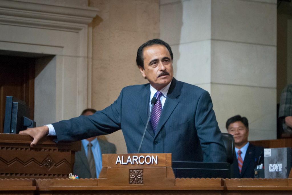 An aide to Los Angeles City Councilman Richard Alarcon was charged with misdemeanor vehicular manslaughter today for allegedly striking and killing a homeless man back in March.