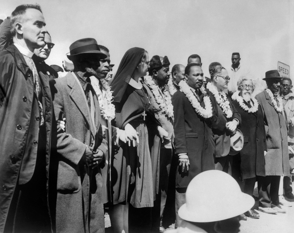 Civil rights demonstrators, led by Dr Martin Luther King (5th R), civil rights activist Ralph Abernathy (5th L), John Lewis (3rd L) and other civil and religious leaders, make their way from Selma to Montgomery on March 22, 1965 in Alabama, on the third leg of the Selma to Montgomery marches. The Selma-to-Montgomery March for voting rights ended three weeks and represented the political and emotional peak of the modern civil rights movement. The first march took place on March 07, 1965 (