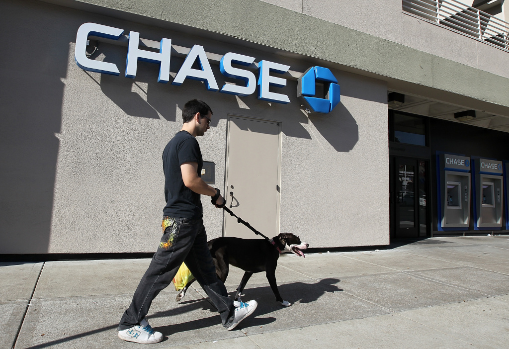 A man walks his dog in front of a Chase bank office on October 13, 2011 in Oakland, California.
