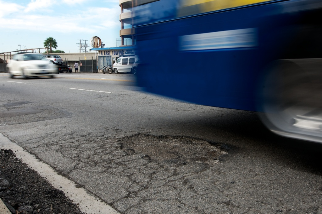 A pothole on Aviation Boulevard near LAX. The city is working on a backlog of reimbursements for car damage because of the numerous potholes that go unfixed.