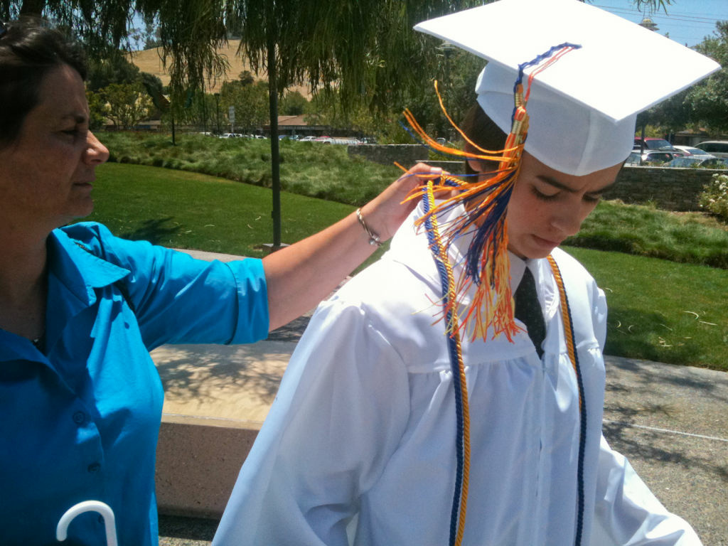 Bridger Zadina, an 18-year-old actor, gets help from his mother Marcy Zadina at his graduation from Capistrano Connections Academy charter school.