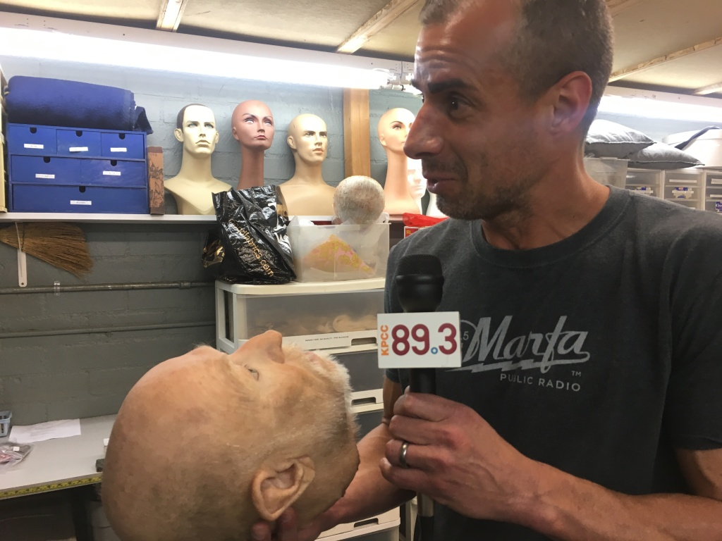 A Martinez holds a decapitated prosthetic head.