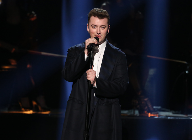In this Nov. 23, 2014, file photo, Sam Smith performs on stage at the 42nd annual American Music Awards at Nokia Theatre L.A. Live in Los Angeles.
