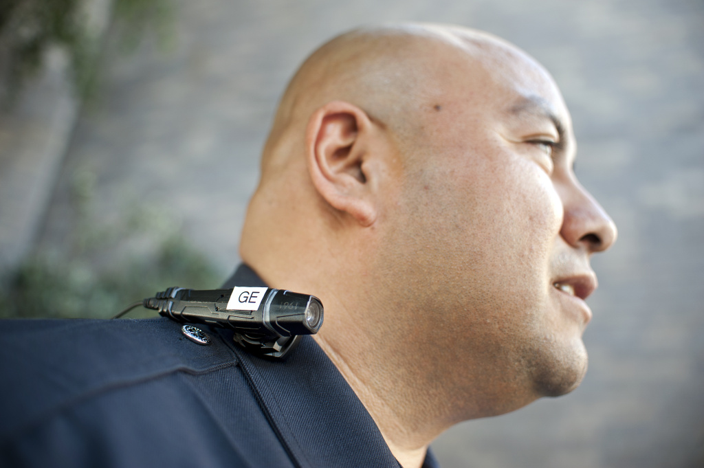 LAPD Officer Guillermo Espinoza wearing a video camera on his lapel in 2014, during a test of the cameras.