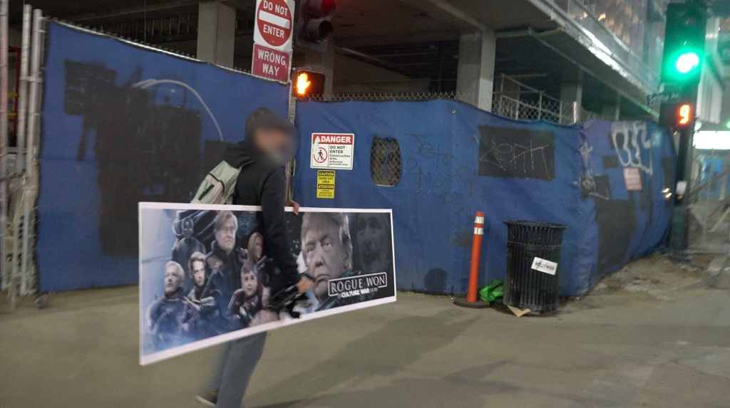 """Conservative street artist Sabo preparing to put up a fake bench ad parodying the movie """"Rogue One."""""""