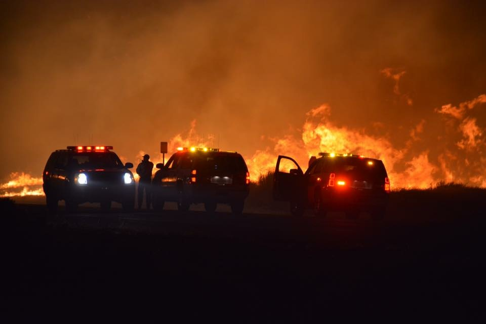 A photo from the Kern County Fire Department shows a new wildfire that broke out late Thursday, June 23, 2016, quickly tearing through dozens of homes and prompting evacuations.