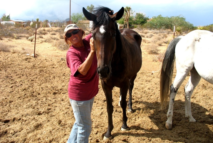 Isabella Megli, proprietor of White Rock Ranch Horse Rescue in the High Desert, with Mystic.