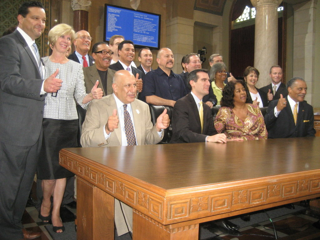 After days of late night negotiations, Los Angeles City Council members and labor union leaders celebrate an agreement that allows up to 2,700 city workers to retire early.  The plan is designed to save the city money as it grapples with a $400 million deficit.