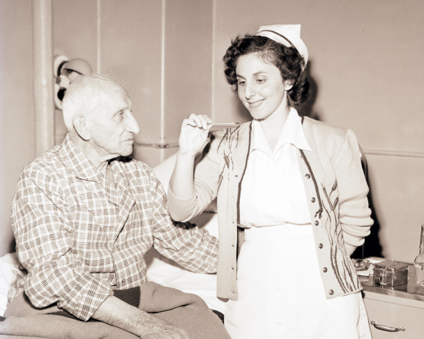 A nurse with 102-year-old Civil War veteran Joe Manning at Wadsworth Hospital in 1948.