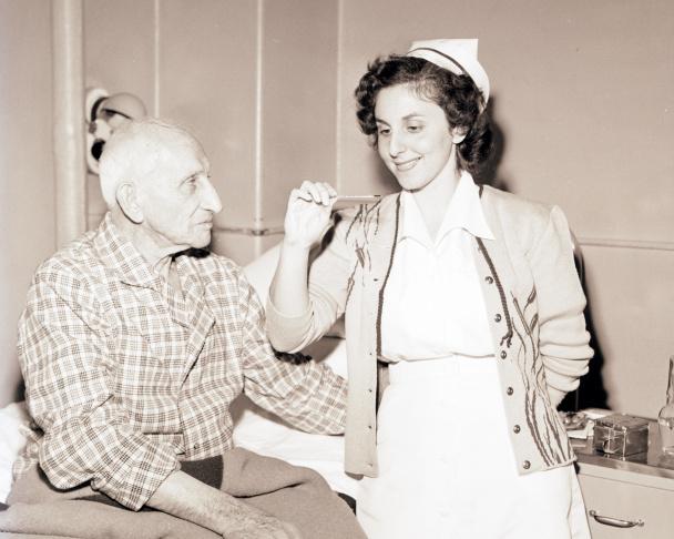 A nurse with 102-year-old Civil War veteran Joe Manning at Wadsworth Hospital in 1948.