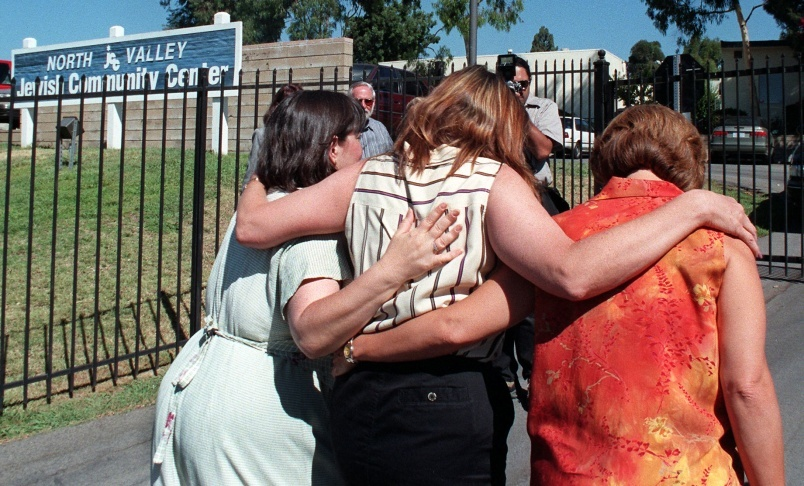Mothers of students that attended the North Valley Jewish Community Center in Granada Hills, California, embrace on 16 August,1999.