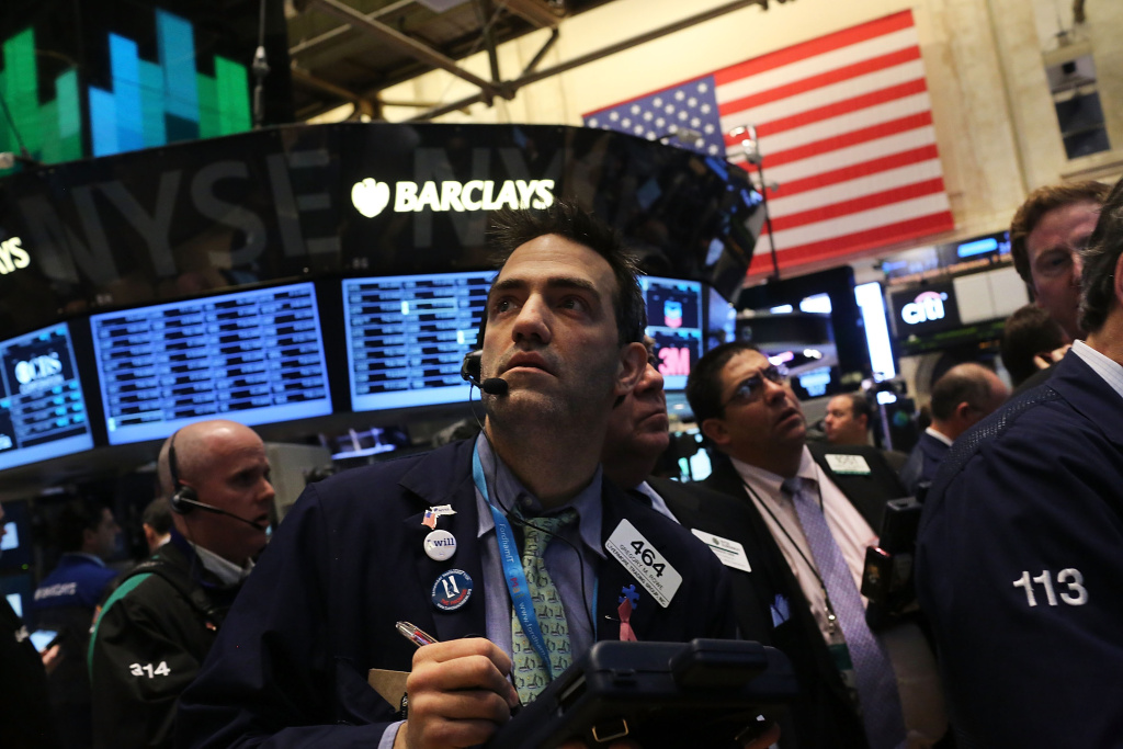 Traders work on the floor of The New York Stock Exchange on March 6, 2013 in New York City. One day after the Dow Jones Industrial Average rallied to a record high to close at 14,253.77, stocks were up over 40 points in morning trading.