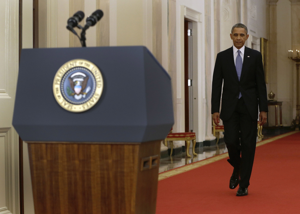 President Obama walks to the podium before addressing the nation in a live televised speech from the East Room of the White House on September 10, 2013 in Washington, DC. President Obama blended the threat of military action with the hope of a diplomatic solution as he works to strip Syria of its chemical weapons.
