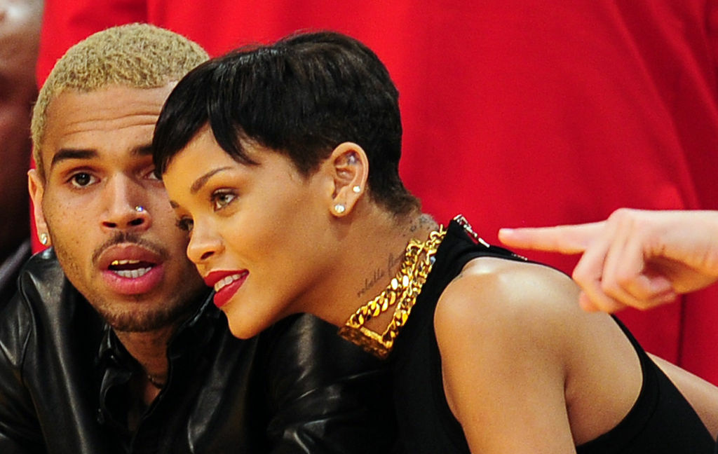 Rihanna and Chris Brown attend a game between the New York Knicks and the Los Angeles Lakers during the NBA game at Staples Center in Los Angeles, California, on December 25, 2012.
