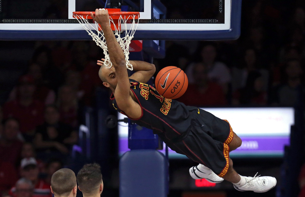 TUCSON, AZ - FEBRUARY 14: Julian Jacobs #12 of the USC Trojans dunks during the first half of the college basketball game against the Arizona Wildcats at McKale Center on February 14, 2016 in Tucson, Arizona. (Photo by Chris Coduto/Getty Images)