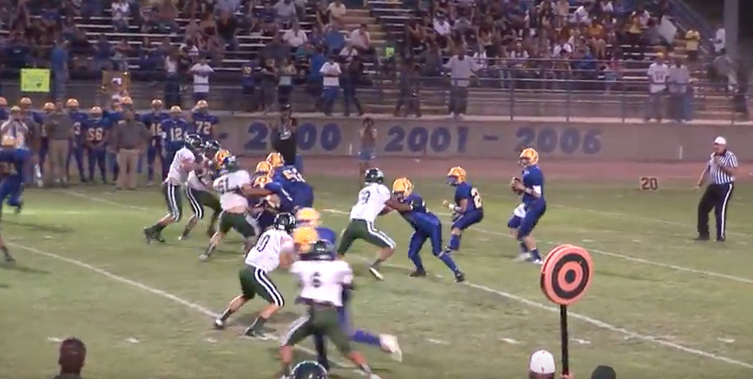 The Dos Palos High football team skirmishes on the field. (Screenshot from Youtube video https://youtu.be/Haah6Vz7JRI)