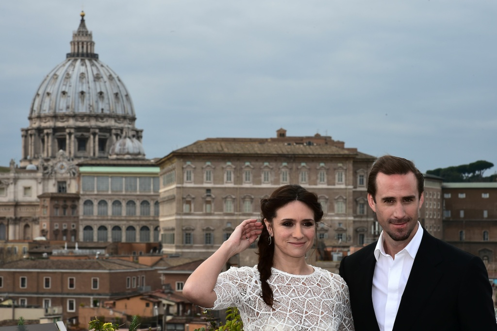 British actor Joseph Fiennes poses with Argentinian actress Maria Botto with the Vatican in the background during a photocall of the movie