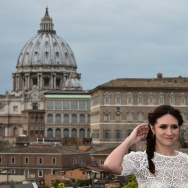 "British actor Joseph Fiennes poses with Argentinian actress Maria Botto with the Vatican in the background during a photocall of the movie ""Risen"" on February 3, 2016 in Rome."