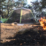 This Saturday, July 8, 2017, photo released by the Santa Barbara County Fire Department shows abandoned campsites at Cachuma Lake where visitors were forced to flee advancing flames of the Whittier fire east of Cachuma Lake in Santa Barbara County, Calif. Wildfires barreled across the baking landscape of the western U.S. and Canada, destroying a smattering of homes, forcing thousands to flee and temporarily trapping children and counselors at a California campground. Southern California crews hope slightly cooler temperatures and diminishing winds will help in the battle Sunday. (Mike Eliason/Santa Barbara County Fire Department via AP)