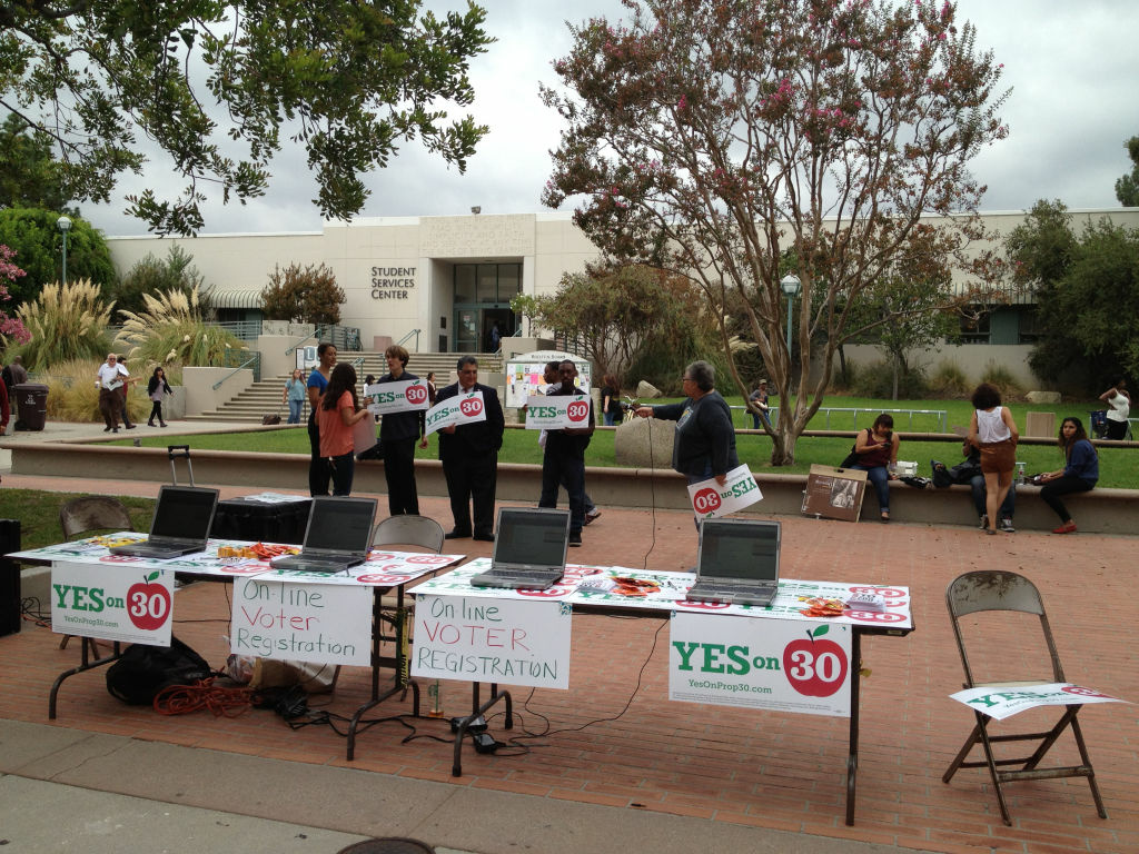 Pasadena City College students gathered in the quad holding