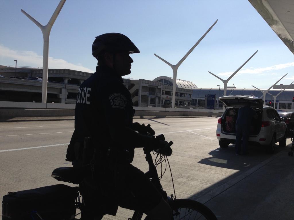 Airport Police Officer O. Gatewood on bike patrol outside Tom Bradley International Airport Thursday, Oct. 30, 2014.