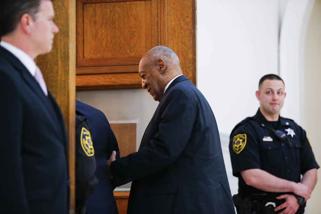 Actor Bill Cosby (R) returns to the courtroom after lunch break in his trial on sexual assault charges at the Montgomery County Courthouse on June 8, 2017 in Norristown, Pennsylvania.