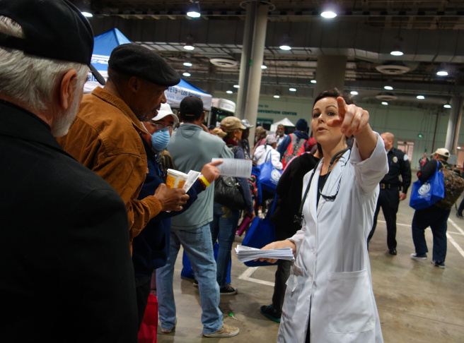 Janel Gehrke directs veterans to free acupuncture services at the Stand Down event at the Los Angeles Convention Center.