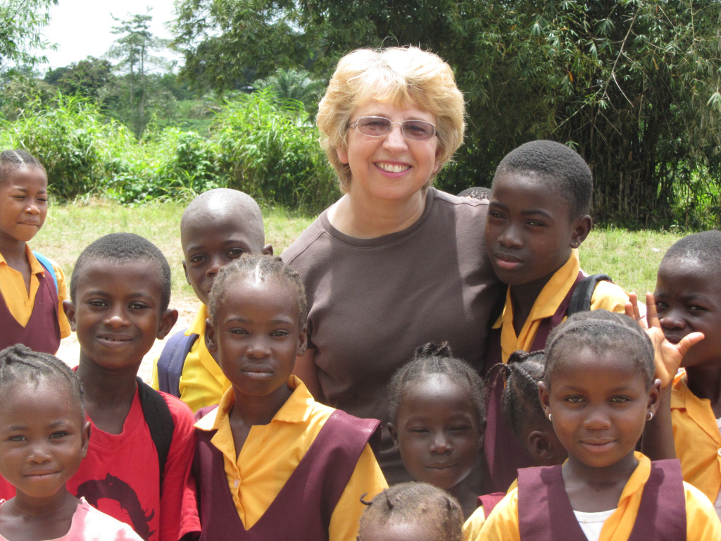 Nancy Writebol with children in Liberia. Writebol is one of two Americans working for a missionary group in Liberia that have been diagnosed with Ebola.