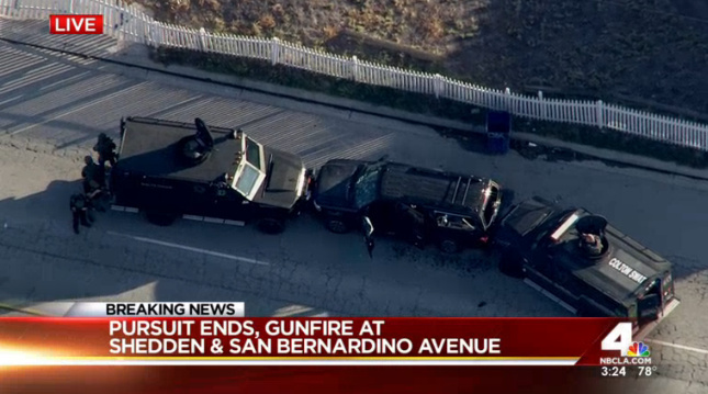 Two military style vehicles block an SUV after a shootout with the couple who carried out the mass shootings in San Bernardino on Dec. 2, 2015. File photo.