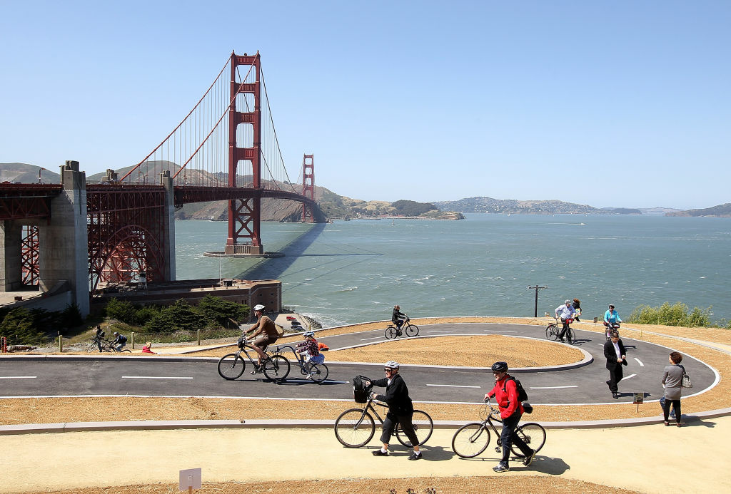 Tourists ride bicycles on a newly constructed bike path near the Golden Gate Bridge on May 24, 2012 in San Francisco, California. The Golden Gate Bridge, Highway and Transportation District is preparing for the 75th anniversary of the iconic Golden Gate Bridge that will be marked with a festival on May 26 - 27 that will feature music, displays of bridge artifacts and art exhibits. The 1.7 mile steel suspension bridge, one of the modern Wonders of the World, opened to traffic on May 27, 1937.