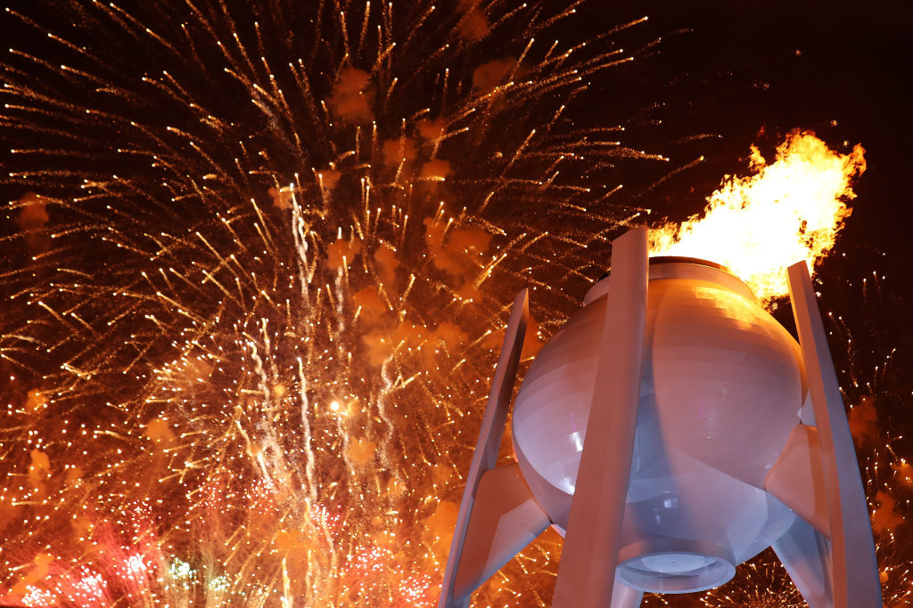 Fireworks erupt as the Olympic Cauldron is lit during the Opening Ceremony of the Pyeongchang 2018 Winter Olympics on February 9, 2018.