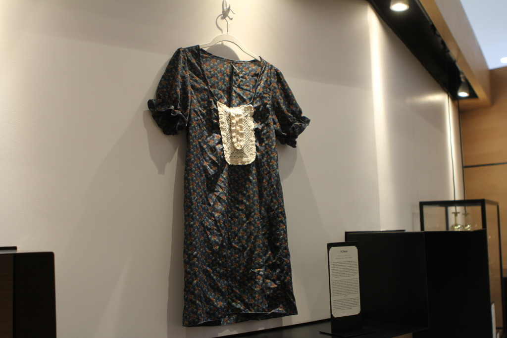 A donated dress hangs in the Museum of Broken Relationships in Los Angeles, Calif.