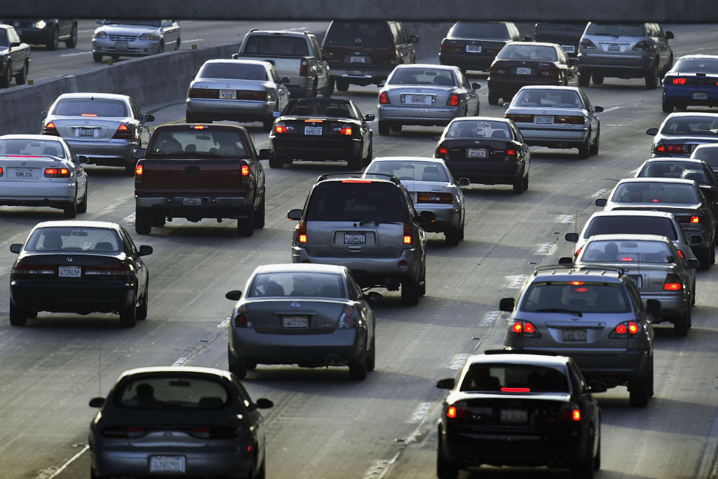 Evening traffic fills the 101 freeway near Hollywood in this June 2004 file photo. The state Assembly  on Tuesday approved a bill that would set a new goal to reduce emissions 40 percent below 1990 levels by 2030.