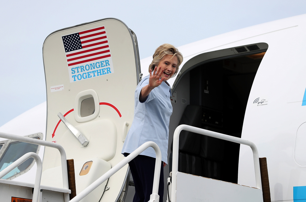 Democratic presidential nominee former Secretary of State Hillary Clinton waves as she boards her new campaign plane at Westchester County Airport.