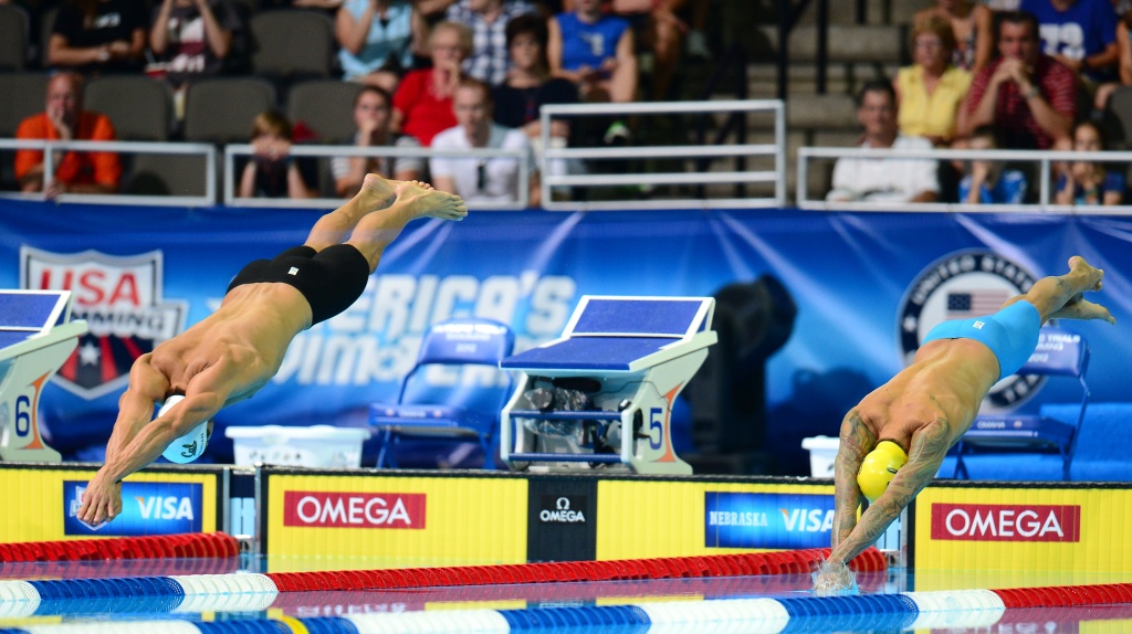 Nathan Adrian (L) and Anthony Ervin (R) start their race in the men's 50M Freestyle final on day seven of the 2012 US Olympic Team Trials on July 1, 2012 in Omaha, Nebraska which was won by Cullen Jones with Ervin finishing second, and Adrian taking third.