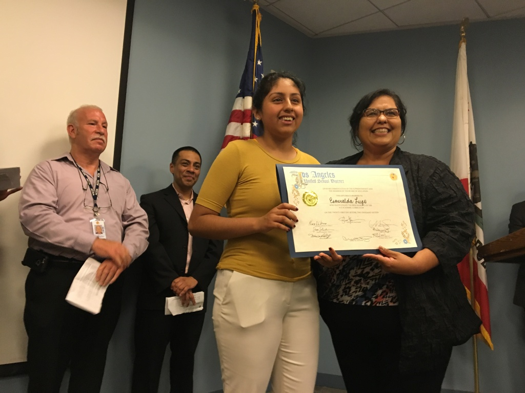 FILE - Los Angeles School Board member Mónica García congratulates recent L.A. Unified graduate Esmerelda Lugo during a ceremony at the district's headquarters on Tuesday, June 21, 2016, as school board members Scott Schmerelson (left) and Ref Rodriguez stand in the background.