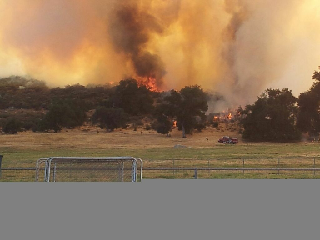 Buck Fire burns at Sage Rd between Lewis Valley Rd and Buck Rd  in the city of Aguanga, about 15 miles south of Hemet.