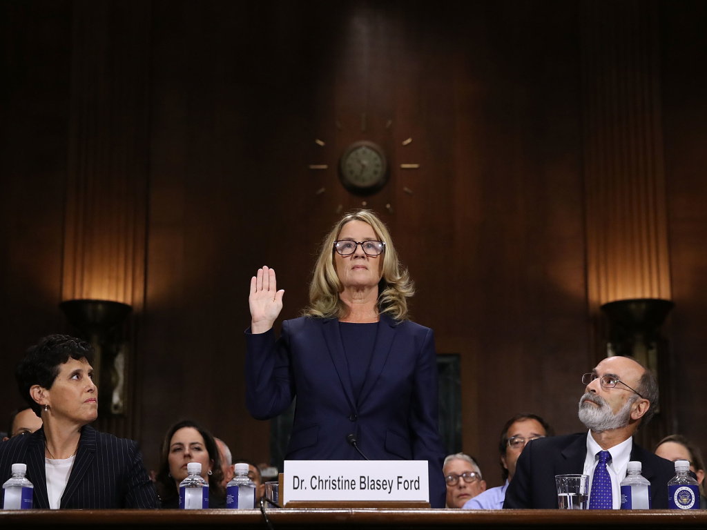 Christine Blasey Ford is sworn in before testifying the Senate Judiciary Committee with her attorneys Debra Katz (left) and Michael Bromwich on Capitol Hill on Thursday