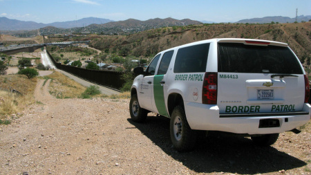 A U.S. Border Patrol truck patrols the fence separating the cities of Nogales, Ariz., and Nogales, Sonora. Congress continues to battle over funding the Department of Homeland Security, which is funded only until the end of this month.