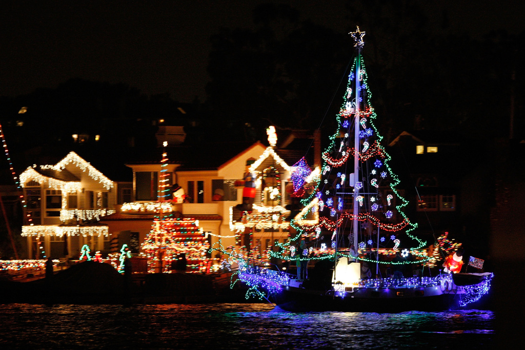 Boats in the 101st annual Newport Beach Christmas Boat Parade are lit with Christmas decorations as they move through through the night on December 16, 2009 in Newport Beach, California.