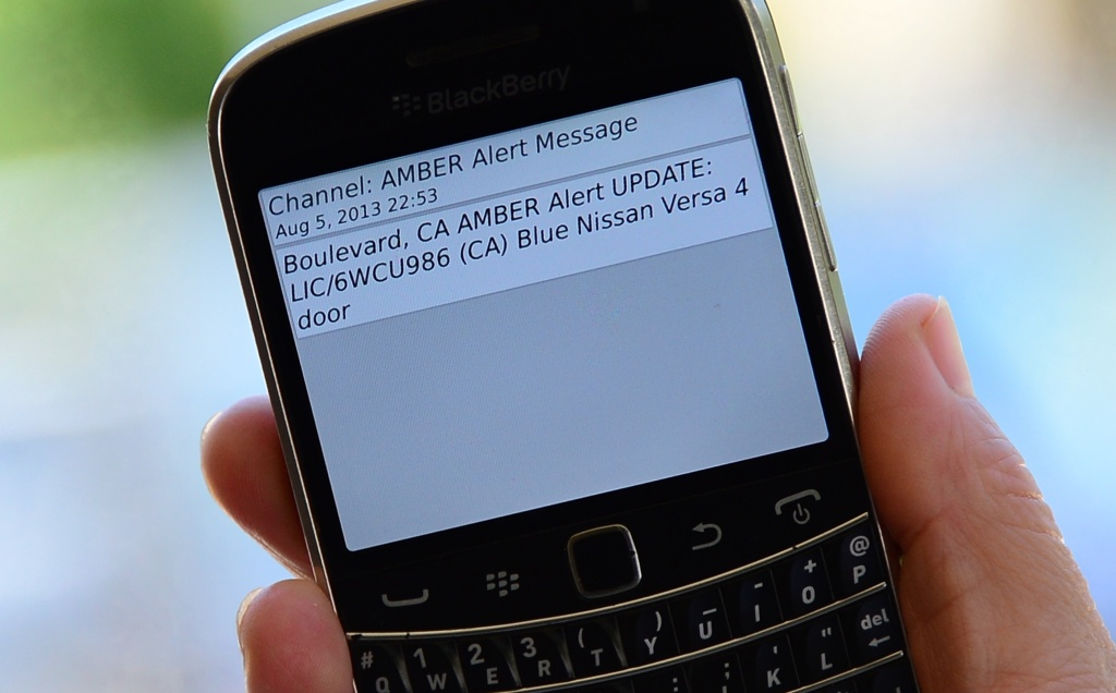 File: A cellphone displays the Amber Alert issued late on August 5, 2013 in Los Angeles which marked the first time officials have notified the public of a statewide Amber Alert through their cellphones.