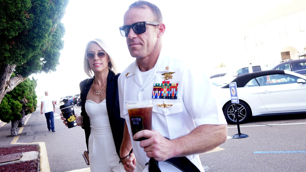 Navy SEAL Special Operations Chief Edward Gallagher walks into a military court building in San Diego along with his wife, Andrea Gallagher, on Tuesday.